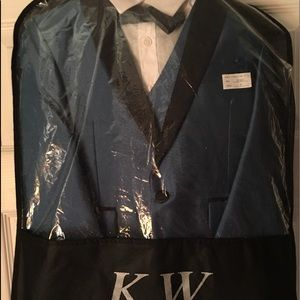 Little boys brand new 5 piece tuxedo/suit size 7.